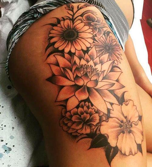Tatuagem na coxa com flor de lótus